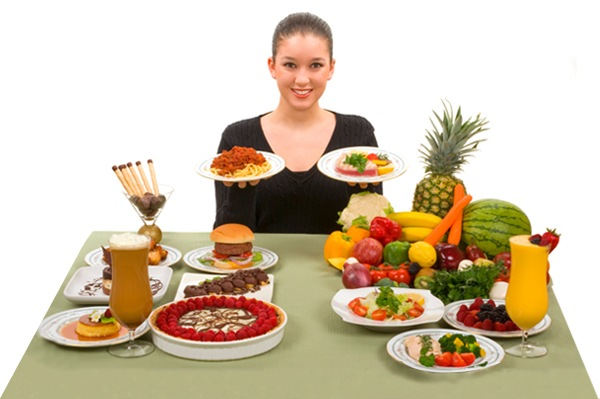 A girl with healthy food around her